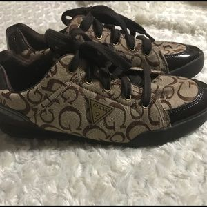 Guess lace up tennis shoes.  Like New Condition